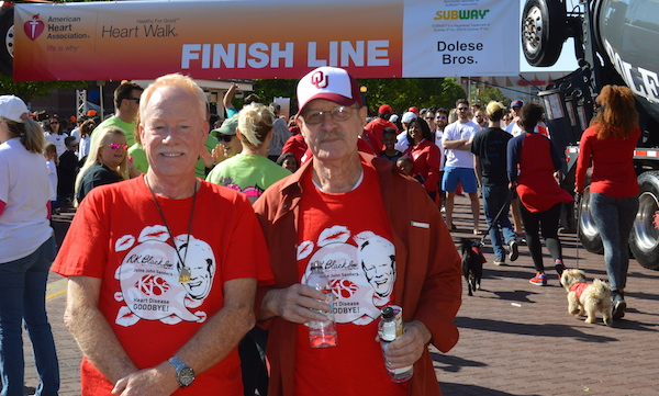 John Sanders and his father pose at the finish line of the 2017 Central Oklahoma Heart Walk