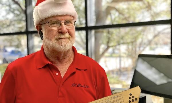 Photo of RK Black service technician (Santa) carrying copier toner