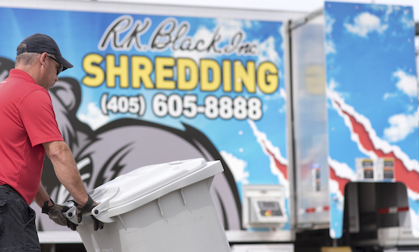 Image of RK Black Shredding shred tech rolling shredding bin to mobile shredding truck