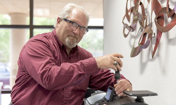 FP Master Tech Glenn Nelms working on an FP postage meter.