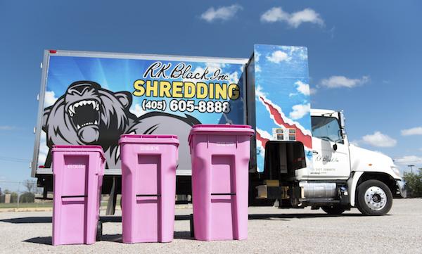 RK Black Shredding mobile shredding unit with pink shred bins for breast cancer awareness.